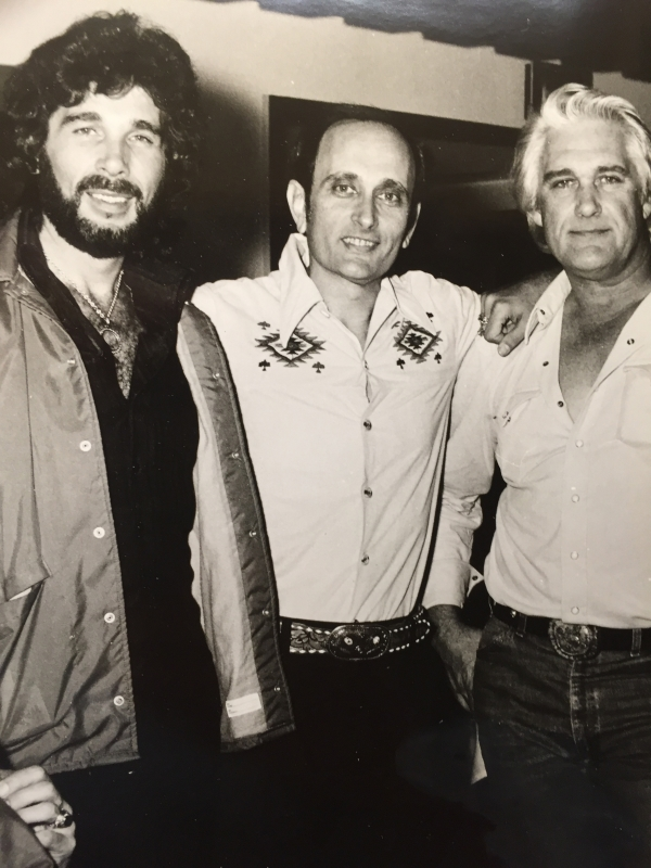 With Eddie Rabbitt to my left and Charlie Rich to my right.  Eddie sang the title song to